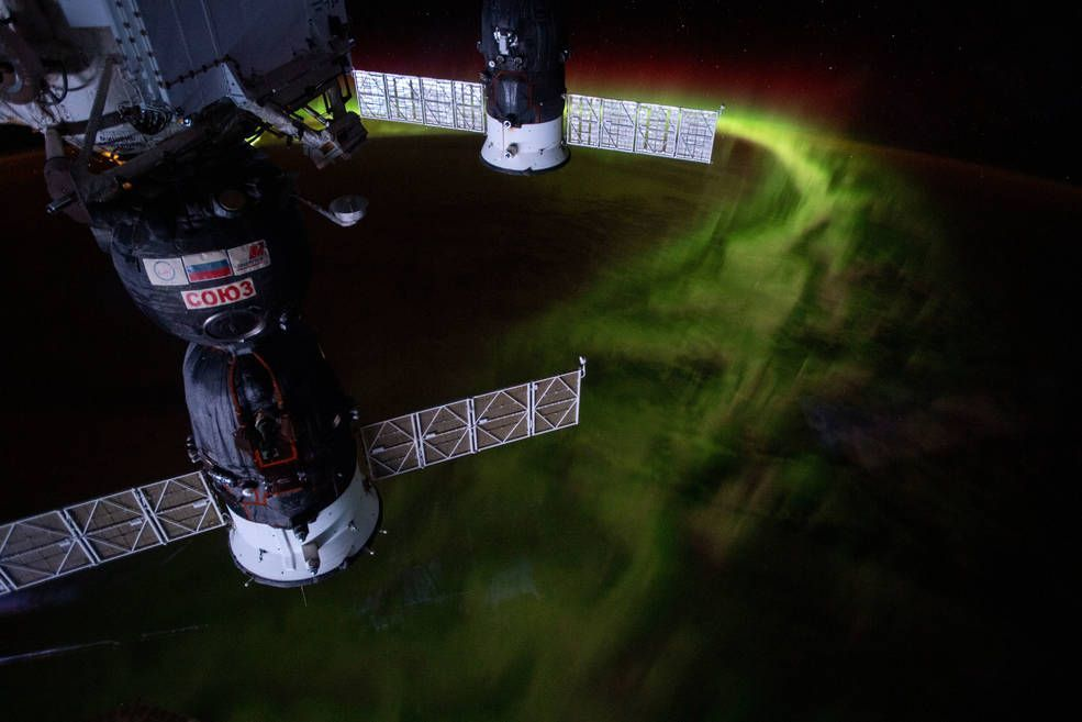 "iss059e099150 (June 8, 2019) --- The International Space Station was orbiting 269 miles above the Indian Ocean southwest of Australia when this nighttime photograph was taken of the aurora australis, or ""southern lights."" Russia's Soyuz MS-12 crew ship (foreground) and Progress 72 resupply ship are seen in this mesmerizing view."