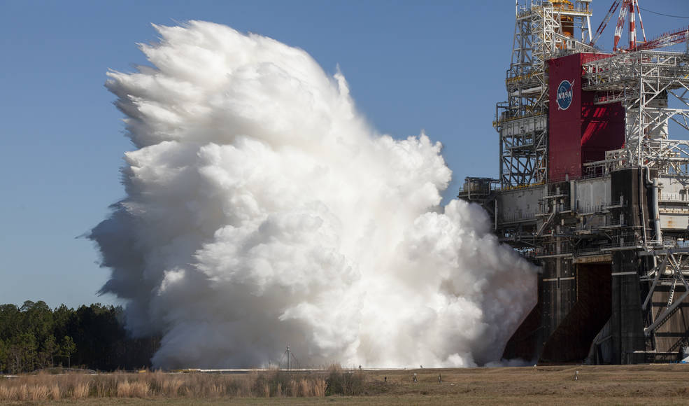 The core stage for the first flight of NASA's Space Launch System rocket is seen in the B-2 Test Stand during a second hot fire test, Thursday, March 18, 2021, at NASA's Stennis Space Center near Bay St. Louis, Mississippi. The four RS-25 engines fired for the full-duration of 8 minutes during the test and generated 1.6 million pounds of thrust. The hot fire test is the final stage of the Green Run test series, a comprehensive assessment of the Space Launch System's core stage prior to launching the Artemis I mission to the Moon.  Photo Credit: (NASA/Robert Markowitz)